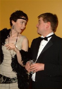 Two people enjoying The Final Curtain - a murder mystery game
